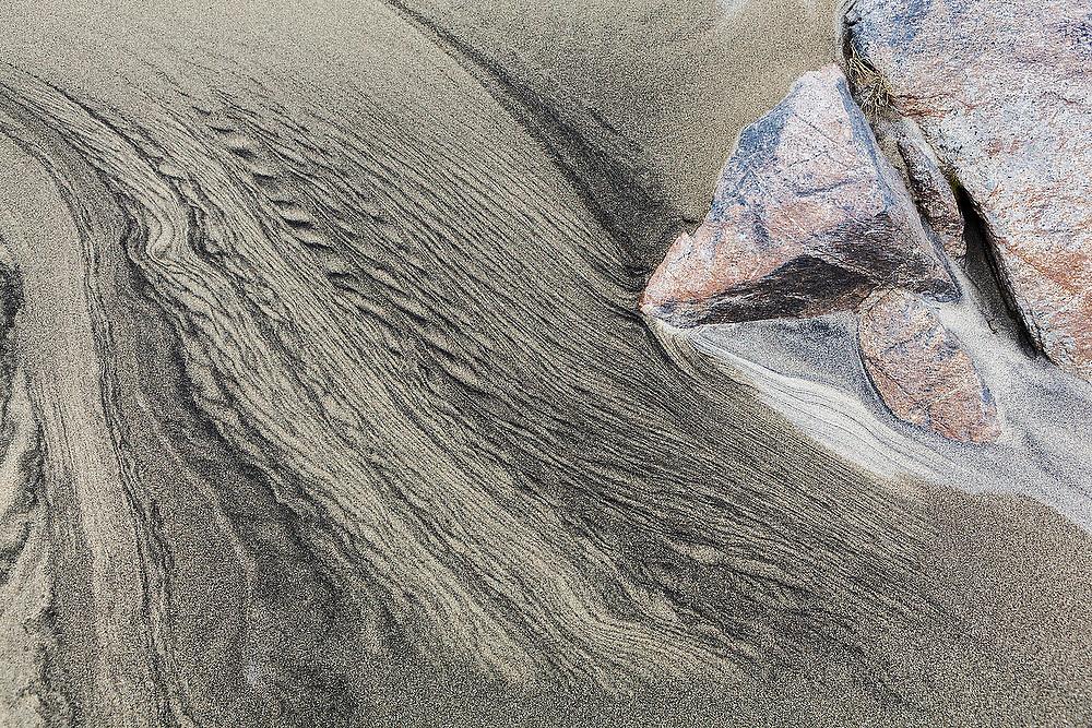 Patterns caused by sediment transport by water in the sand on Bunes Beach, Moskenesoya, Lofoten Islands, Norway.