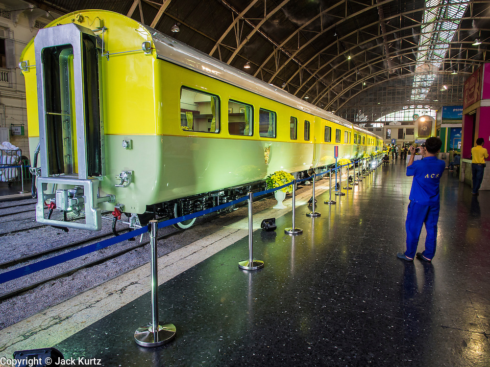 """05 DECEMBER 2013 - BANGKOK, THAILAND:  The King's personal train on display at Hua Lamphong Train Station on the 86th birthday of Bhumibol Adulyadej, the King of Thailand. Dec. 5, the King's Birthday, is a national holiday in Thailand, and is also celebrated as the country's """"Fathers' Day."""" The State Railways of Thailand put on special trains to take people to the King's """"Summer Palace"""" in the oceanside community of Hua Hin where the King granted a public audience. There were also merit making ceremonies throughout the country.  Many people wear yellow on the King's Birthday because yellow is the color associated with his reign. As of 2013, he was the longest reigning monarch in the world.          PHOTO BY JACK KURTZ"""