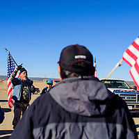 112614       Cable Hoover<br /> <br /> Larry Anderson addresses a crowd of supporters at the start of a protest march in Window Rock Wednesday.