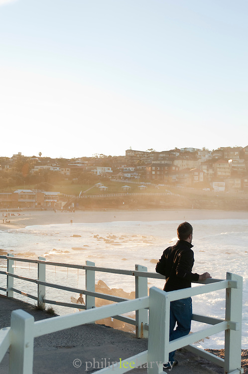 Man looking over Bronte Beach in Sydney, New South Wales, Australia