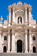 Tourist visitor at cathedral Duomo di Siracusa - Temple of Minerva - Tempio di Minerva - front elevation in Piazza Duomo, Ortigia, Sicily, Italy