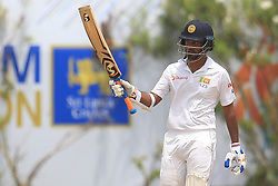 July 29, 2017 - Galle, Sri Lanka - Sri Lankan cricketer Dimuth Karunaratne raises his bat after scoring 50 runs during the 4th Day's play in the 1st Test match between Sri Lanka and India at the Galle cricket stadium, Galle, Sri Lanka on Saturday 29 July 2017. (Credit Image: © Tharaka Basnayaka/NurPhoto via ZUMA Press)