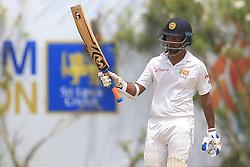 July 29, 2017 - Galle, Sri Lanka - Sri Lankan cricketer Dimuth Karunaratne raises his bat after scoring 50 runs during the 4th Day's play in the 1st Test match between Sri Lanka and India at the Galle cricket stadium, Galle, Sri Lanka on Saturday 29 July 2017. (Credit Image: © Tharaka Basnayaka/NurPhoto via ZUMA Press)