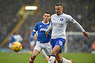 Portsmouth Forward, Conor Chaplin (19) and Mansfield Town Defender, Kyle Howkins (15) during the EFL Sky Bet League 2 match between Portsmouth and Mansfield Town at Fratton Park, Portsmouth, England on 12 November 2016. Photo by Adam Rivers.