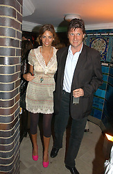 ROSE HANBURY and LORD JOHNSTON SOMERSET at the Quintessentially Summer Party held at Debenham House, 8 Addison Road, London W14 on 15th June 2006.<br />