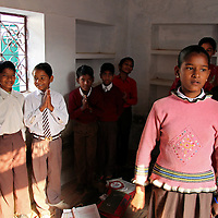 Asia, India, Khajuraho. A young girl recites numbers in english while her classmates watch.