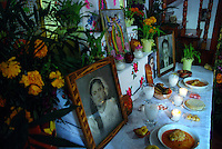 """MEXICO, Veracruz, Tantoyuca, Oct 27- Nov 4, 2009. On the first night, special dishes are set out for children's souls. """"Xantolo,"""" the Nahuatl word for """"Santos,"""" or holy, marks a week-long period during which the whole Huasteca region of northern Veracruz state prepares for """"Dia de los Muertos,"""" the Day of the Dead. For children on the nights of October 31st and adults on November 1st, there is costumed dancing in the streets, and a carnival atmosphere, while Mexican families also honor the yearly return of the souls of their relatives at home and in the graveyards, with flower-bedecked altars and the foods their loved ones preferred in life. Photographs for HOY by Jay Dunn."""