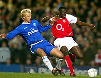 Photo: Scott Heavey.<br />Chelsea v Arsenal. Champions League Quarter Final, First Leg. 24/03/2004.<br />Eidur Gudjohnsen is shoved off the ball by Kolo Toure