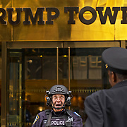 A New York City police officer engages in conversation with colleagues at the  entrance of Trump Tower on 5th Avenue in New York City.  Leica M10 / Summicron 50mm APO
