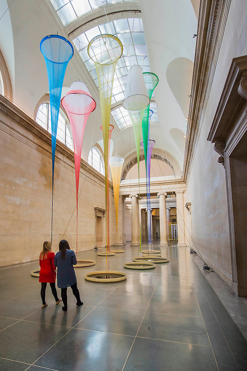 the filters by Christina Mackie - a three-part installation for the annual Tate Britain Commission. This invites artists to make new work in response to the grand spaces of the Duveen Galleries. These have been transformed by a composition of 12-metre-high dipped silk nets suspended over pans of semi-crystallised dye, anchored to the floor by hand cast weights. Alongside this aerial network of ropes and colourful dyed silk is a vibrant yellow sculpture and a plinth displaying chunks of raw glass.