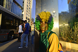 June 27, 2018 - Sao Paulo, Brazil - Ana Luiza dos Anjos Garcez is a fanatical fan of the Seleção and a stamped figure that calls attention to games, protests and other televised events in São Paulo. An iconic figure, it is known as 'Animal' and circulated characterized by the green and yellow colors of the Brazilian flag on Wednesday morning, on June 27, 2018 on Avenida Paulista in São Paulo on the game day of Brazil. (Credit Image: © Cris Faga/NurPhoto via ZUMA Press)