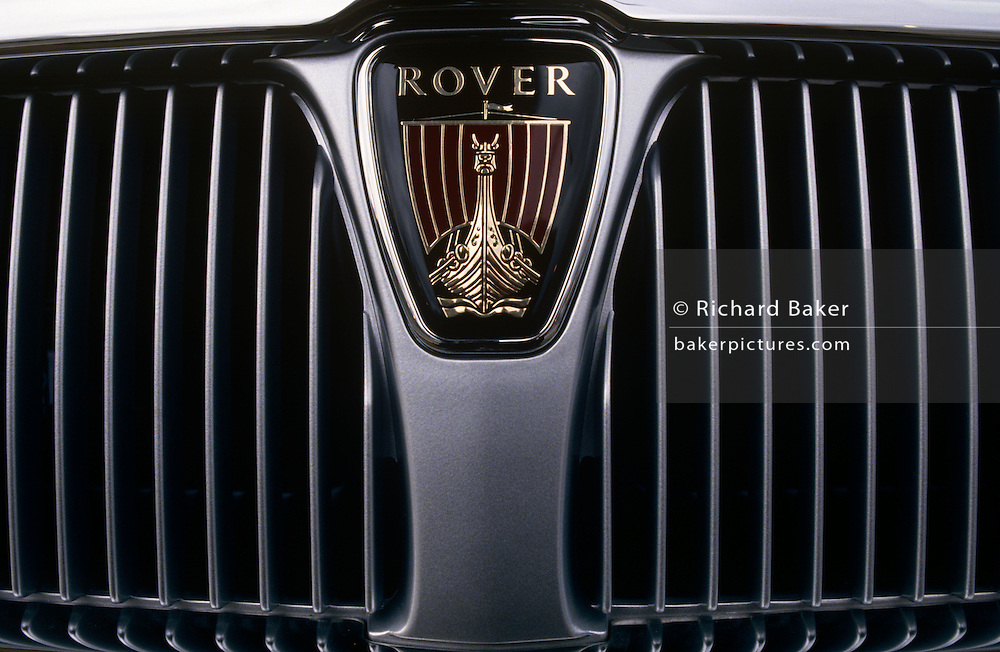 A detail of a Rover grill in the German BMW-owned Rover production factory in Cowley, Solihull, England. With the car manufacturer's logo of a Viking longship prominent, is the silver radiator guard. Motor car production has taken place at Cowley near the city of Oxford, England for over ninety years. The car factory is known today as Plant Oxford and is now owned by BMW and has been extensively redeveloped. It remains the largest industrial employer in Oxfordshire employing more than 4,300 people.
