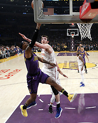 January 4, 2019 - Los Angeles, California, U.S - Los Angeles LakersÃ• Kentavious Caldwell-Pope (1) goes to basket while defended by New York Knicks' Luke Kornet (2) during an NBA basketball game between Los Angeles Lakers and New York Knicks on Friday, Jan. 4, 2019, in Los Angeles. (Credit Image: © Ringo Chiu/ZUMA Wire)