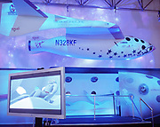 A computer-generated astronaut lies down on board a space flight on Virgin Galactic's  SpaceShipTwo's,  unveiled as a replica model during Wired NextFest at the Jacob K. Javits Convention Center, New York. Under construction by Burt Rutan in Mojave, California and looking more like '2001 A Space Odyssey,' than future everyday holidays, SpaceShipTwo is a re-usable orbiting vehicle that will become an important tool for Man's leisure time in space when affordable commercial space tourism starting in 2009/10. Aboard the space vehicle will be 6 passengers, each paying $200,000 for the 40 minute flight to 360,000 feet (109.73km, or 68.18 miles) and to experience 6 minutes of weighlessness. From these circular portholes, astronauts will see 1,000 miles having taken off from the new Spaceport America, New Mexico.
