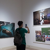 Visitors watch photos on display at the World Press Photo exhibition in Budapest, Hungary on Sept. 23, 2020. ATTILA VOLGYI