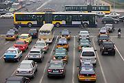 Bendybus and traffic on Beijing main street, China