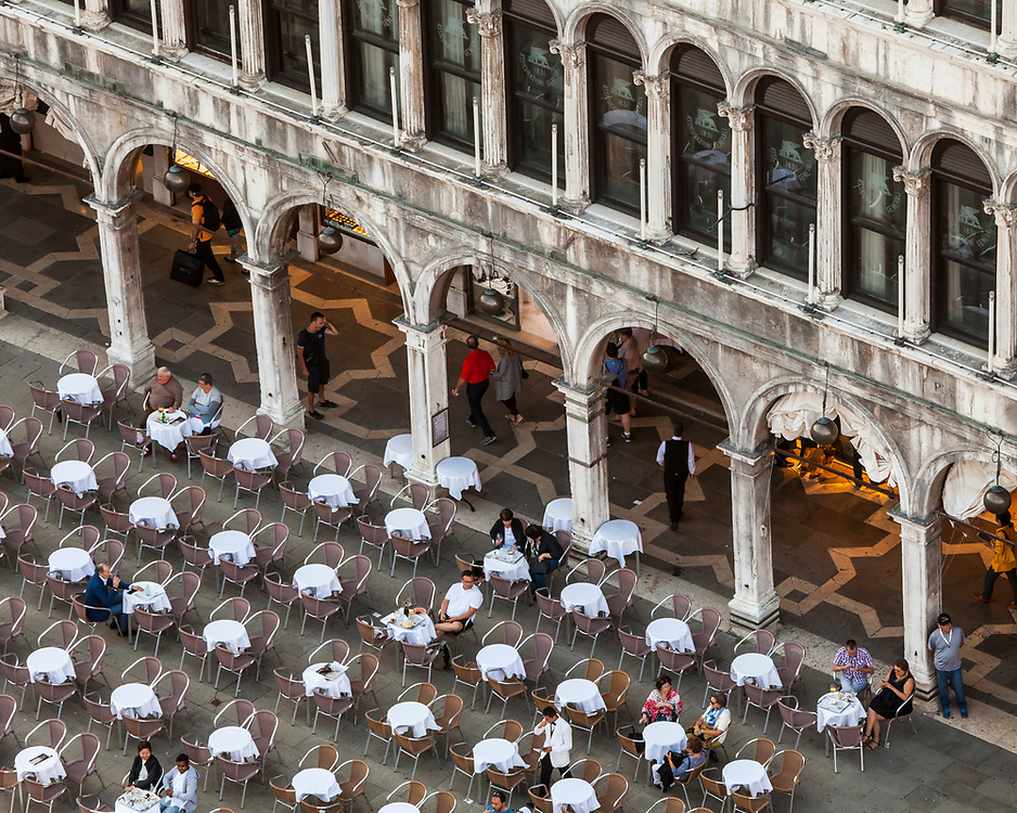 Looking down on an outdoor cafe in San Marcos Square, Venice, Italy.