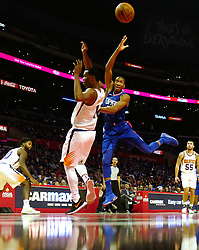 October 21, 2017 - Los Angeles, California, U.S. - Los Angeles Clippers forward Wesley Johnson, right, drives to the basket over Phoenix Suns forward TJ Warren in the second half during an NBA basketball game at the Staples Center on Saturday, Oct 21, 2017 in Los Angeles. .(Photo by Keith Birmingham, Pasadena Star-News/SCNG) (Credit Image: © San Gabriel Valley Tribune via ZUMA Wire)