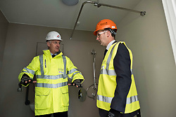 Pictured: Michael Matheson and Morrison Construction's project Director Phil Galbraith check out one of the ensuite facilities<br /> <br /> Infrastructure Secretary Michael Matheson visited East Lothian Community Hospital's construction site today to give an update on the Scottish Government's infrastructure programme, on the same day as an annual progress report is published<br /> <br /> Ger Harley   EEm 17 April 2019