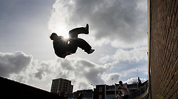 © Licensed to London News Pictures. 04/03/2017. Guildford, UK. Free runners train after holding a memorial to remember Nye Newman who died in January. Nye Newman, whose death is thought not to be related to Parkour, died in Paris. Free running or Parkour involves jumping and climbing on building, railings and walls.  Photo credit: Peter Macdiarmid/LNP