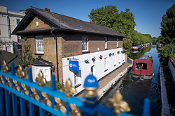 © Licensed to London News Pictures. 23/06/2020. London, UK. A canalboat makes it way along the towpath of Grand Union Canal at Little Venice in central London at the beginning of a warm summers day. Record temperatures are expected this week as the UK starts to relax lockdown restrictions, introduced earlier this year to prevent the spread of COVID-19. Photo credit: Ben Cawthra/LNP