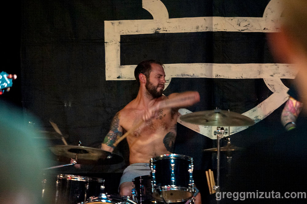 Sam Gates. Delta Mud performs at the Landlocked Show, June 1, 2019 at the Mardi Gras in Boise, Idaho.<br /> <br /> The 2nd annual Landlocked Motorcycle Show was presented by DicE Magazine and Rawhide Cycles in association with Harley Davidson.<br /> <br /> Delta Mud is a Boise Idaho based band steeped in the rough and rowdy culture. Members: Johnny Kunk (guitar, vocals), Sam Gates (drums), Tamilla Macklin (bass, vocals).