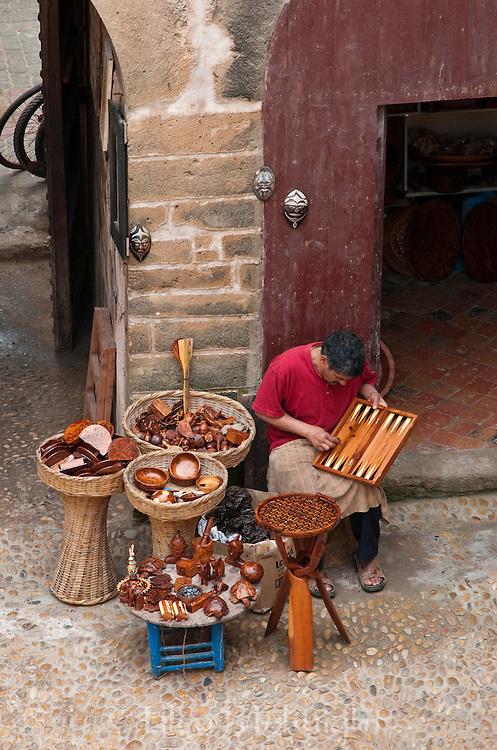 Artisan outside his shop in Essaouira, Morocco