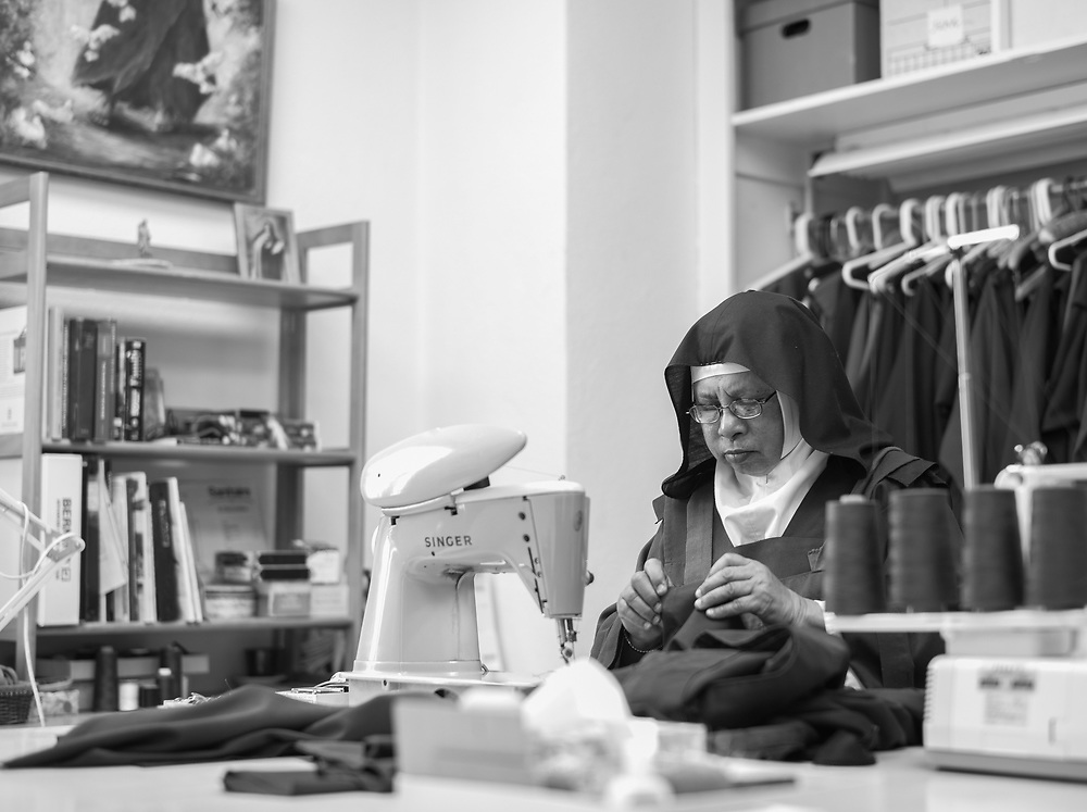 Sister Rose Mary sews habits on Jan. 10, 2019. The nuns' lifestyle may seem Old World, but they are not fully cut off from society. They keep up with the news of the outside world and have email to help facilitate monastery business. Visitors can catch up with them for short amounts of time, but Mother Teresita says their days are pretty regimented with their life's calling to prayer.