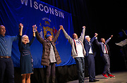 Tony Evers, Mandela Barnes and their families celebrate on stage during the Election Night watch party at the Orpheum Theater in Madison, Wisconsin, Wednesday, Nov. 7, 2018.