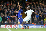Danilo of FC Porto tackles Diego Costa of Chelsea. UEFA Champions league group G match, Chelsea v Porto at Stamford Bridge in London on Wednesday 9th December 2015.<br /> pic by John Patrick Fletcher, Andrew Orchard sports photography.