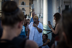 August 28, 2017 - Rome, Italy - in the pictured Gemma Vecchio, President of Casa Africa Onlus during  Sit-in for the right to a home in Madonna di Loreto square near Piazza Venezia in Rome, Italy, on 28 August 2017  organized by refugees evacuated from the Independence Square building. (Credit Image: © Andrea Ronchini/NurPhoto via ZUMA Press)
