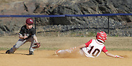 Chester, New York  - A fielder reaches to tag a baserunner during the TRUMP March Madness youth baseball tournament at The Rock Sports Park on March 17, 2012. ©Tom Bushey / The Image Works