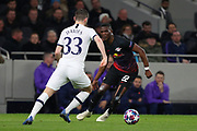 Defender Ben Davies of Tottenham and Defender Nordi Mukiele Of Leipzig compete for the ball during the UEFA Champions League match between Tottenham Hotspur and RB Leipzig, at The Tottenham Hotspur Stadium, Thursday, Feb. 20 2020,  in  London, United Kingdom. (Mitchell Gunn/Image of Sport)