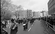 Sinn Fein (Provo) Dublin Parade.   K22..1976..25.04.1976..04.25.1976..25th April 1976..Sinn Fein held an Easter Rising Commemorative  parade..The parade started at St Stephens Green, Dublin and proceeded through the streets to the G.P.O.in O'Connell Street, the scene of the centre of the 1916 uprising..Picture shows the parade forming under the watchful eyes of the gardai.