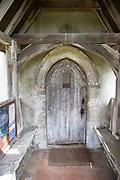 Historic door in porch 18th century, Church of Saint Mary, Badley, Suffolk, England, UK