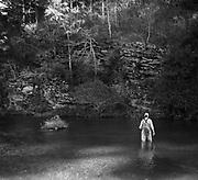 "Trout fishing at Beaver's Bend State Park, shot on 4""x5"" black and white Kodak Plus-X Pan film."