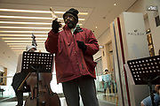 Singer Stephen Bowen performs Thats just Life, isnt it? from the Birmingham Opera Company inside The Mailbox to an audience, during the Birmingham Weekender Arts And Culture Festival on 23rd September 2017 in Birmingham, United Kingdom.