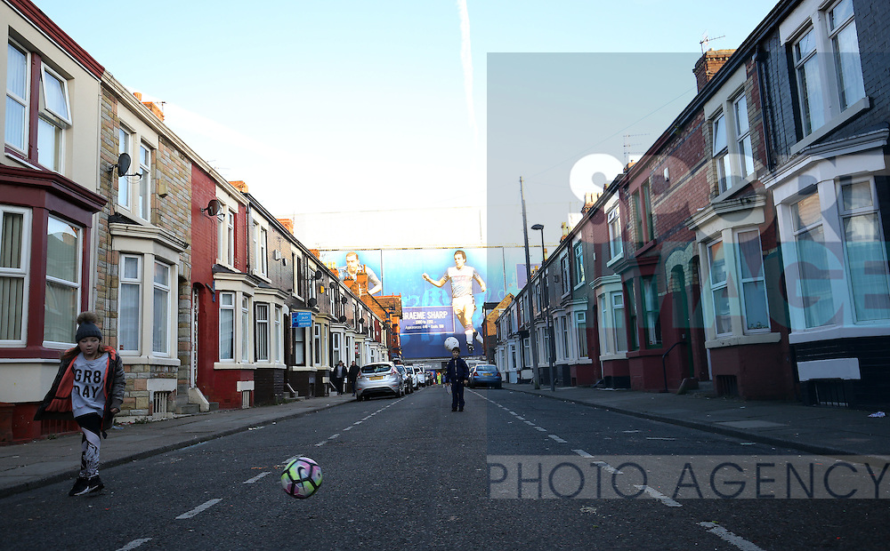 Kids playing in the street before the Premier League match at Goodison Park, Liverpool. Picture date: December 4th, 2016.Photo credit should read: Lynne Cameron/Sportimage