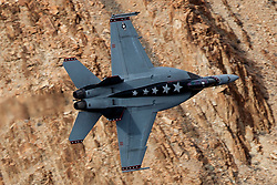 Boeing F/A-18E Super Hornet (XE 111, CAG bird) from United States Navy VX-9 Vampires squadron, Naval Air Weapons Station China Lake, flies low level through the Jedi Transition, Star Wars Canyon, Death Valley National Park, California, United States of America