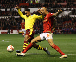 Andre Gray of Burnley (L) and Kelvin Wilson of Nottingham Forest in action - Mandatory byline: Jack Phillips / JMP - 07966386802 - 20/10/2015 - FOOTBALL - The City Ground - Nottingham, Nottinghamshire - Nottingham Forest v Burnley - Sky Bet Championship