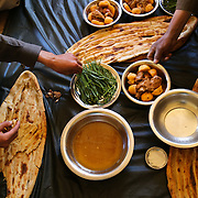 A feast prepared in Medair's honor at a rural farmer's home in Panjab District, Bamyan Province, Afghanistan.