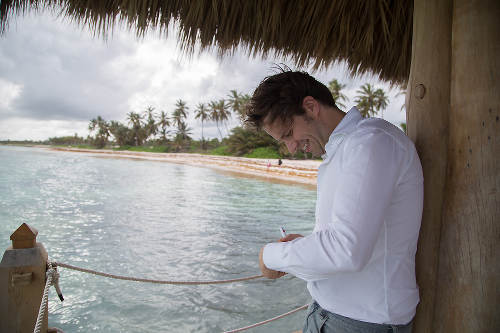 PUNTA CANA, DOMINICAN REPUBLIC-DECEMBER 4, 2014: Der Spiegel writer Martin U. Muller at work in Punta Cana. Story on tourism to the Caribbean Island.  (Photo by Angel Valentin/Getty Images for Der Spiegel)