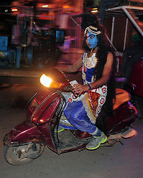 September 26, 2016 - Allahabad, Uttar Pradesh, India - Allahabad: An Artist dressed as Lord Shiva drive scooty ahead of a religious procession Ravan ki Barat in Allahabad on September 26, 2016, held to mark the Dussehra festival. The name Dussehra is derived from Sanskrit Dasha-hara literally means removal of ten referring to Lord Rama's victory over the ten-headed demon king Ravana. Dussehra is celebrated on the tenth day of the month of Ashwin according to the Hindu calendar which corresponds to September or October of the Gregorian calendar. (Credit Image: © Prabhat Kumar Verma via ZUMA Wire)