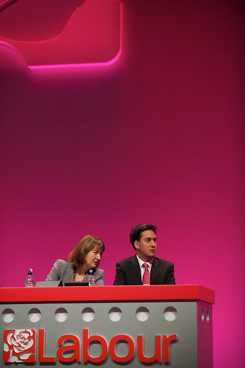 Ed Miliband and Harriet Harman confer during the Labour Party Conference in Manchester on 29 September 2010, the penultimate day of annual assembly.