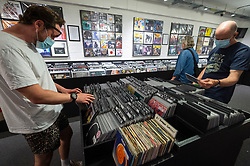 © Licensed to London News Pictures. 12/06/2021. LONDON, UK. Customers in Sister Ray Records in Soho on Record Store Day, where independent record shops worldwide celebrate music, including special vinyl releases made exclusively for the day. In the UK, vinyl sales have increased for the 13th consecutive year.  The BPI reported that nearly 5m records were sold in the 2020 in the UK as, with more time spent at home, music lovers had time to add to their collections.  Photo credit: Stephen Chung/LNP