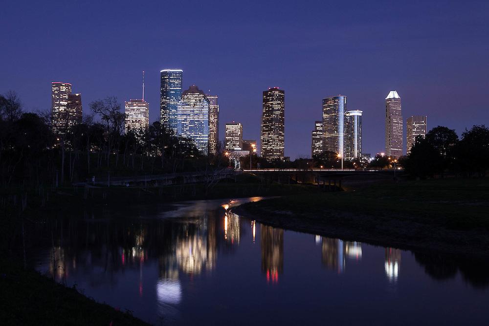 Houston, Texas skyline reflected in Buffalo Bayou at night.