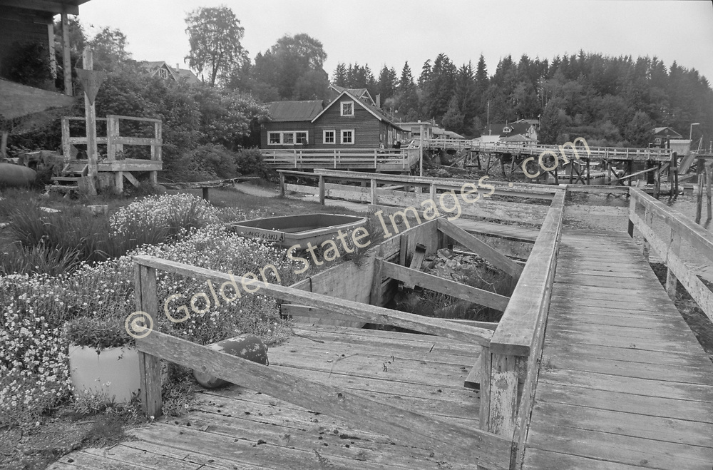 Grayscale - Black and White version of BCL-011. <br /> <br /> Bamfield is a small fishing town on the exposed west side of Vancouver Island.