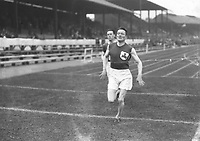 H912<br /> Aonach Tailteann Athletics - Croke Park. Man winning race. 1928. (Part of the Independent Newspapers Ireland/NLI Collection)