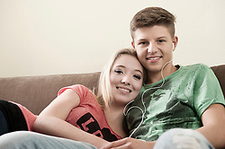 Portrait of teenage couple on couch