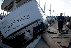 03 Oct, 2005.  New Orleans, Louisiana.  Hurricane Katrina aftermath.<br /> Smashed yachts at the Southern Yacht Club on the shores of Lake Pontchatrain in Lakeshore, New Orleans. The irony of boat names.<br /> Photo; ©Charlie Varley/varleypix.com